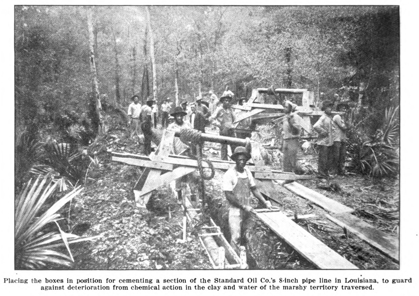 Laying a Standard Oil pipeline in Louisiana swamp.
